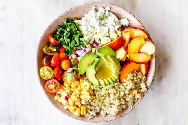 summer quinoa salad ingredients in bowl