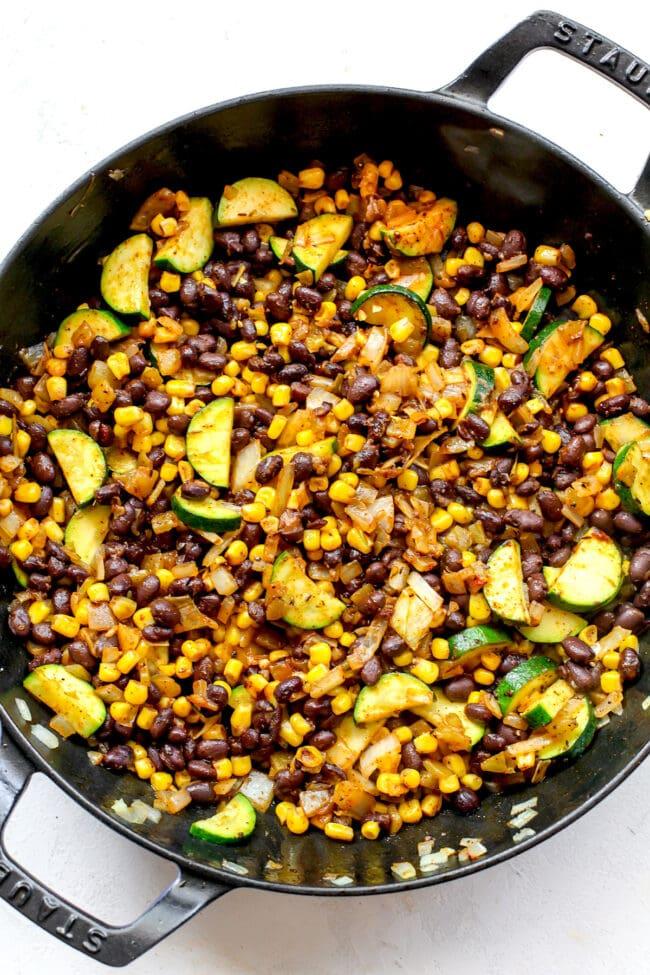zucchini and corn enchilada filling in skillet