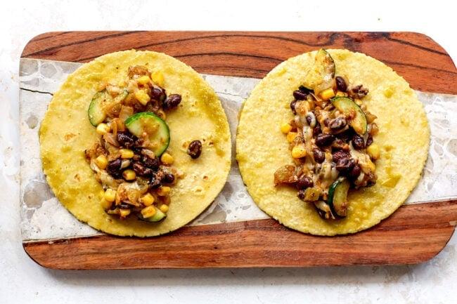 corn and zucchini enchilada filling on corn tortillas