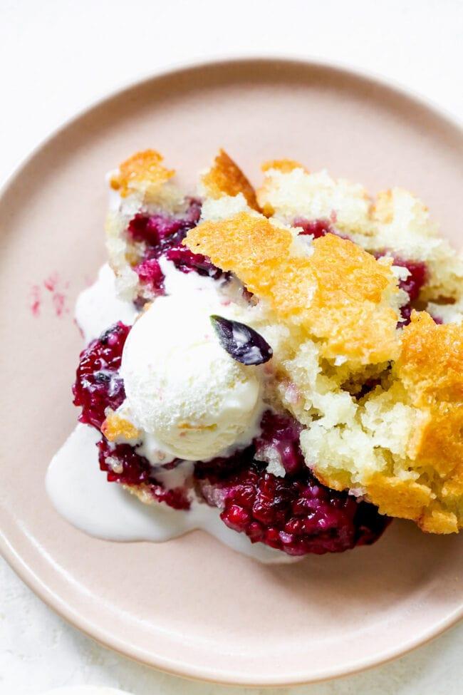blackberry cobbler on plate with vanilla ice cream