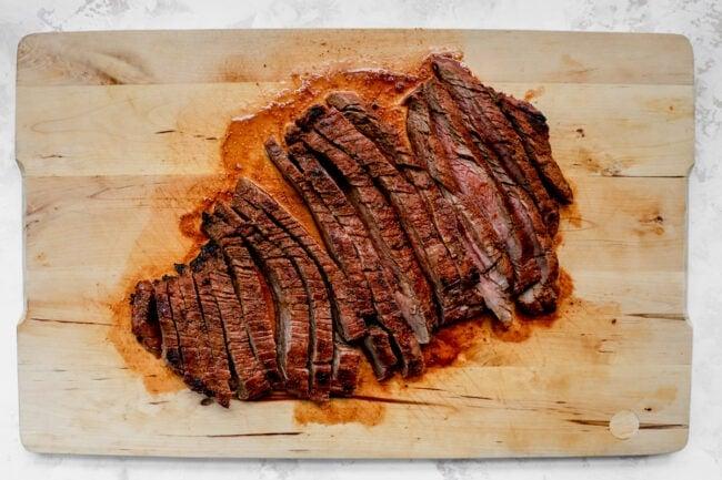 steak sliced on cutting board for steak salad