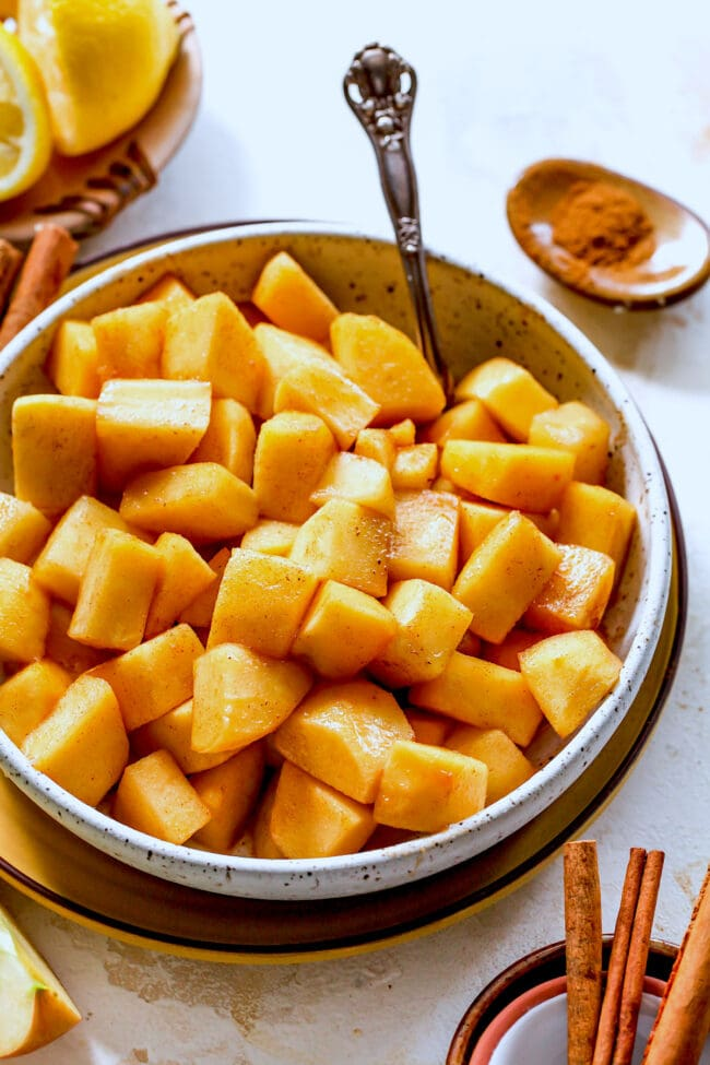 cinnamon apples in bowl with spoon