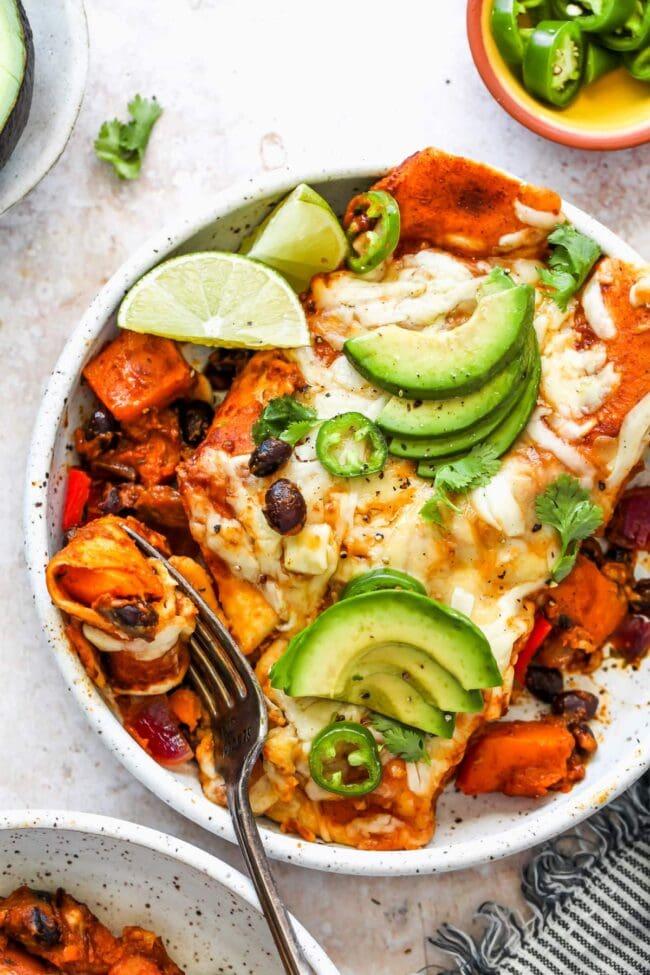Butternut Squash enchiladas on plate with fork