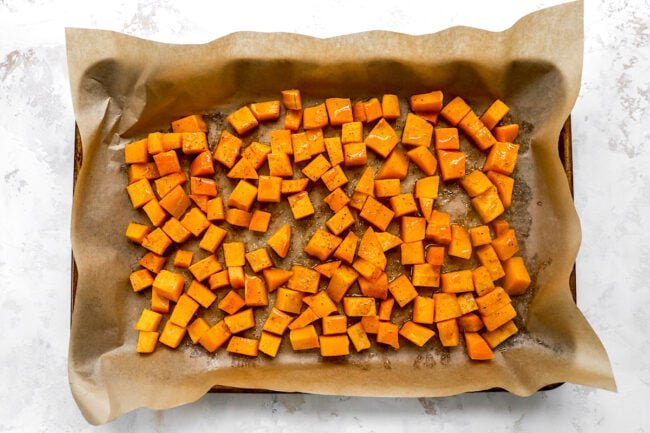 Roasted butternut squash on pan for Brown Butter Ravioli with Butternut Squash Recipe