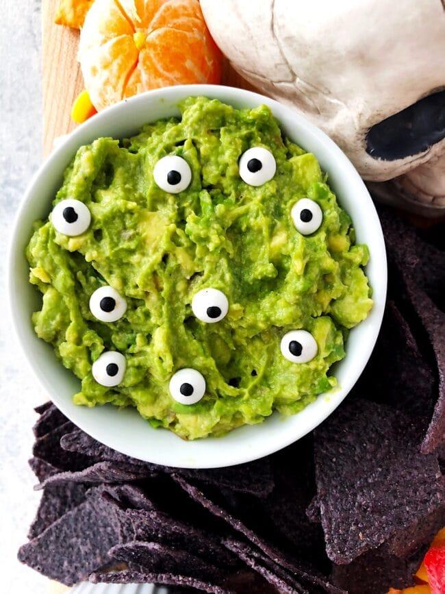 Spooky Guacamole on Halloween Snack Board