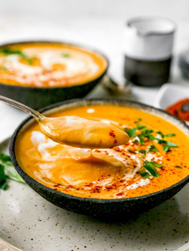 bowl of sweet potato soup with spoon