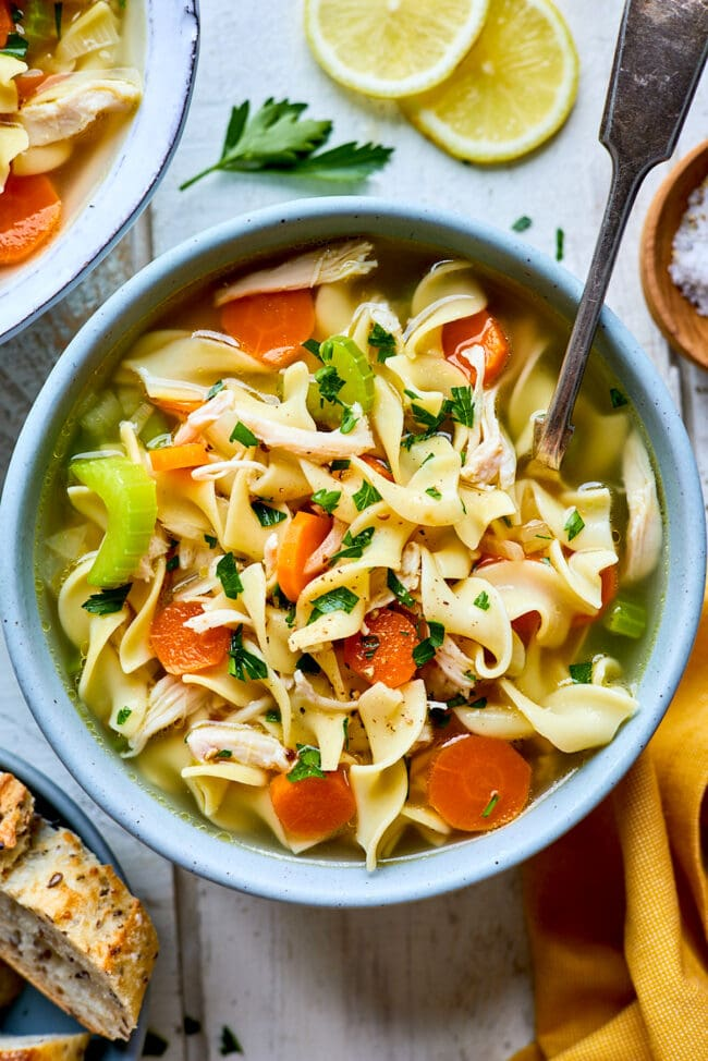 chicken noodle soup in bowl with spoon