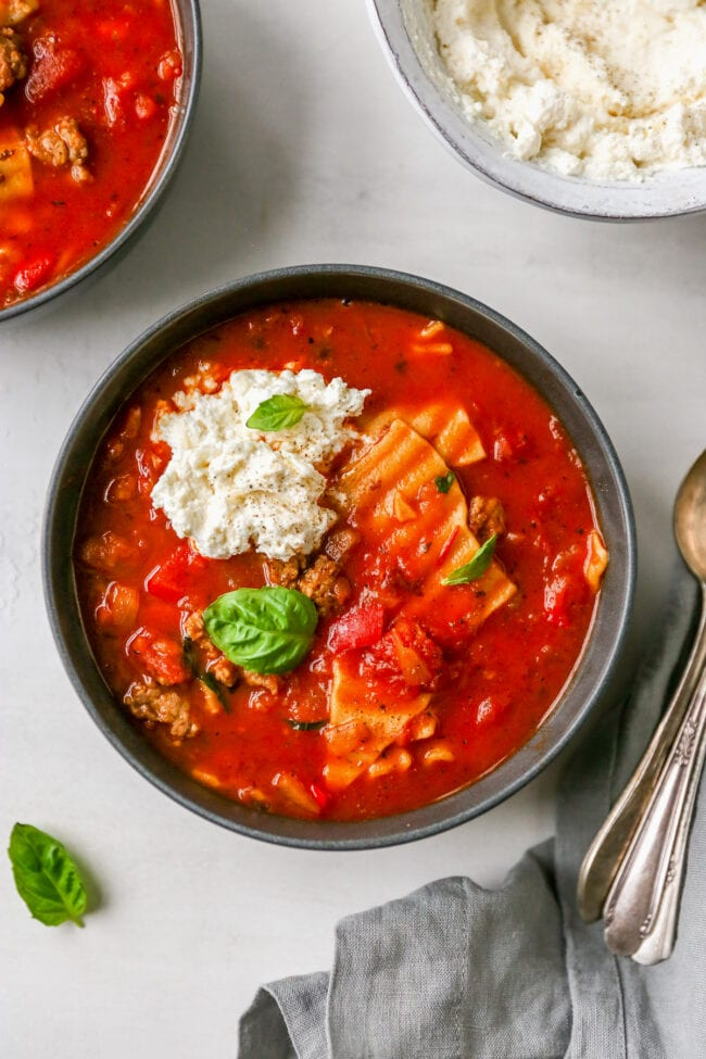 Lasagna soup in bowl with ricotta cheese