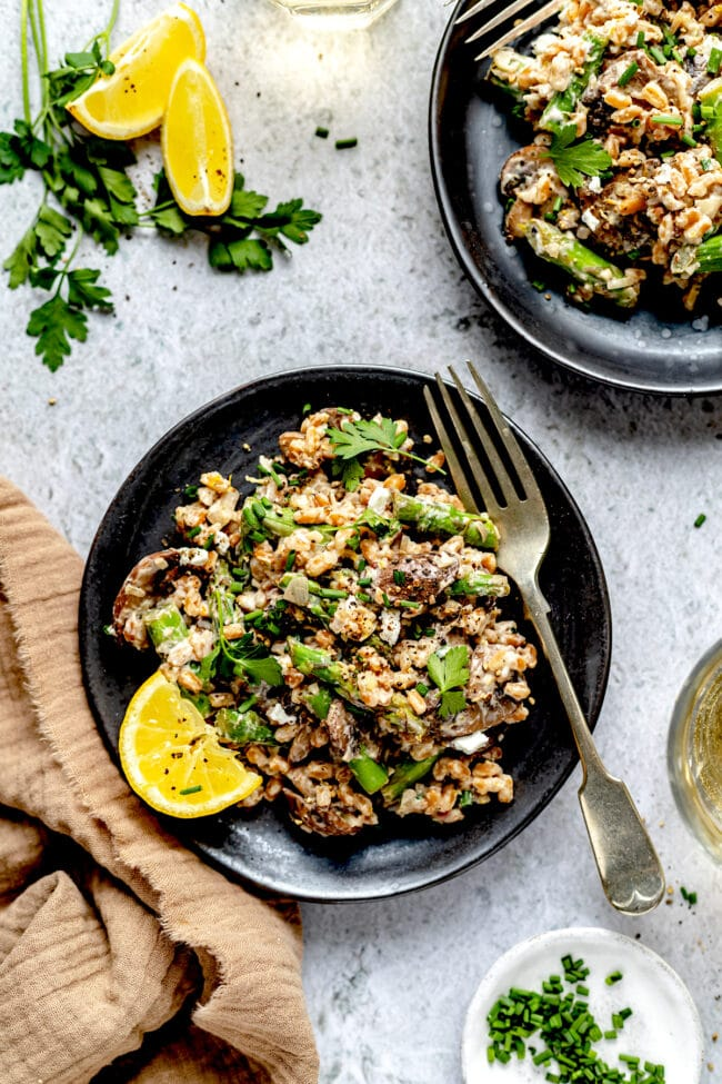 farro with mushrooms and asparagus on plate with fork