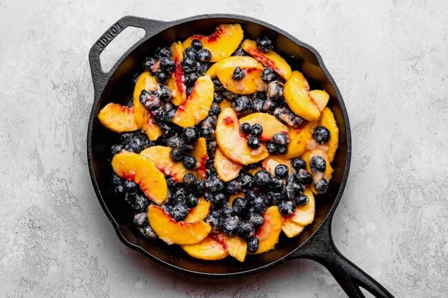 blueberry peach crumble ingredients in pan